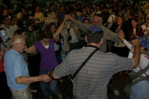 Olim, families dance at Ben-Gurion Airport at aliyah arrival ceremony, July 22, 2008. Photo by Jacob Richman